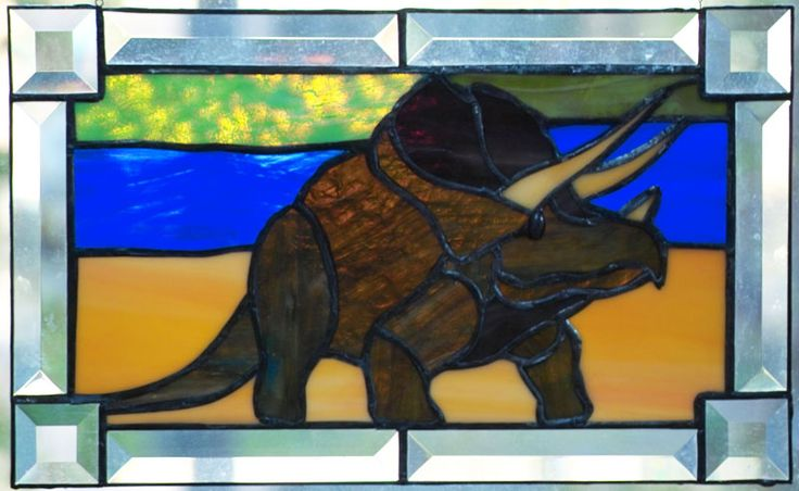 Stained glass suncatcher of a dinosaur of the type Triceratops