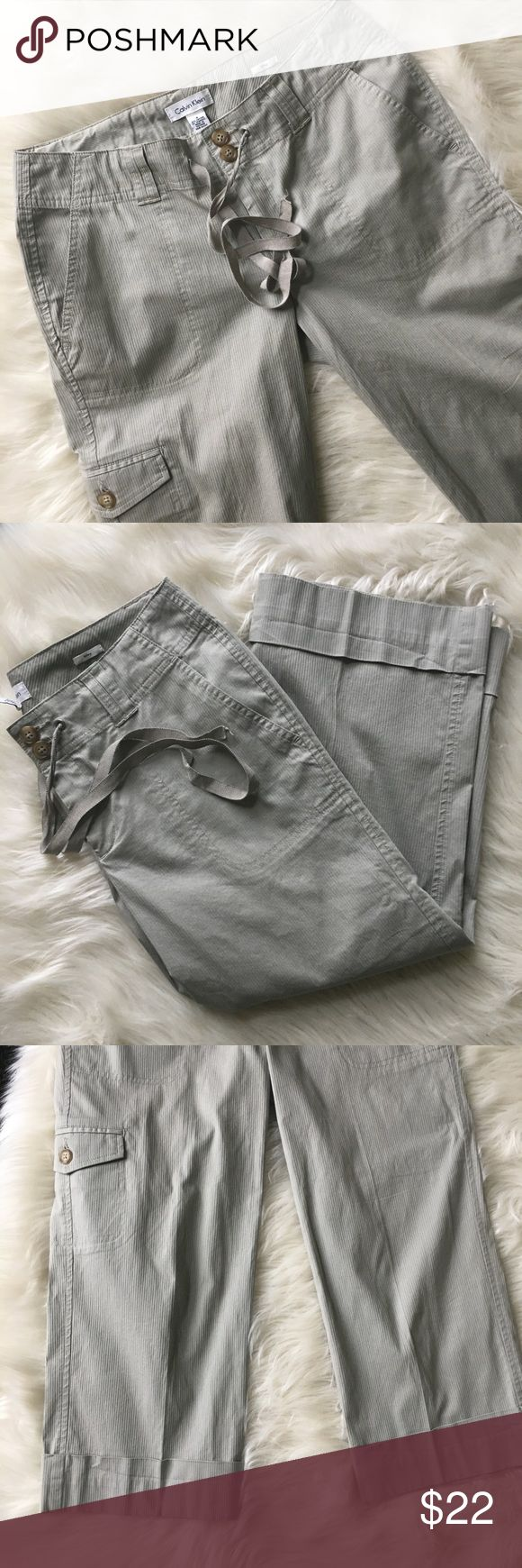 """Nwot Calvin Klein Capri pants Nwot never worn Calvin Klein women's Capri folded pants side 4. 97% cotton 3% spandex. 2 Button and tie waist. Inseam 20"""". Rise laying flat 11 1/2"""". Beige khaki color Calvin Klein Pants Capris"""