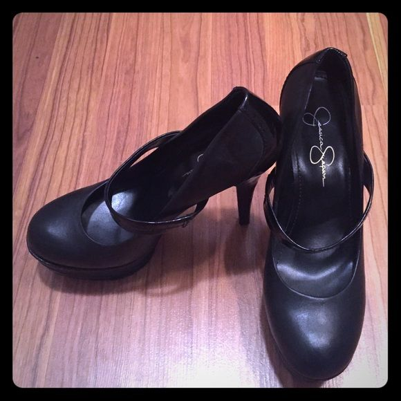 Jessica Simpson Pumps These are one of my FAV pairs of pumps! Black Jessica Simpsons with a strap over the middle of your foot. Platform in the front. Great condition! Jessica Simpson Shoes Heels