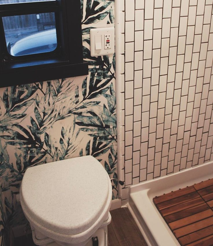 Tiny house bathroom complete with subway tile, jungalicious wallpaper and a composting toilet.  Skoolie bathroom, van, bus, whiz palace -- @nuroost