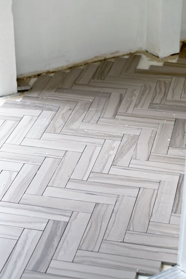 Sarah m dorsey designs two weekends herringbone tile for Small bathroom herringbone tile