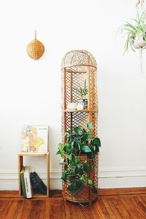 """Vintage wicker/rattan plant stand, in good vintage condition and marked """"made in Spain."""""""
