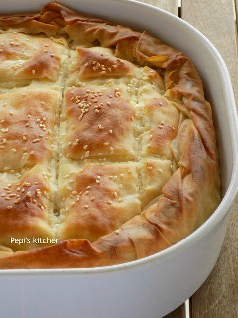Cheese pie with Xinomyzithra and Bechamel Sauce http://pepiskitcheninenglish.blogspot.gr/2017/01/cheese-pie-with-xinomyzithra-and-bechamel-sauce.html