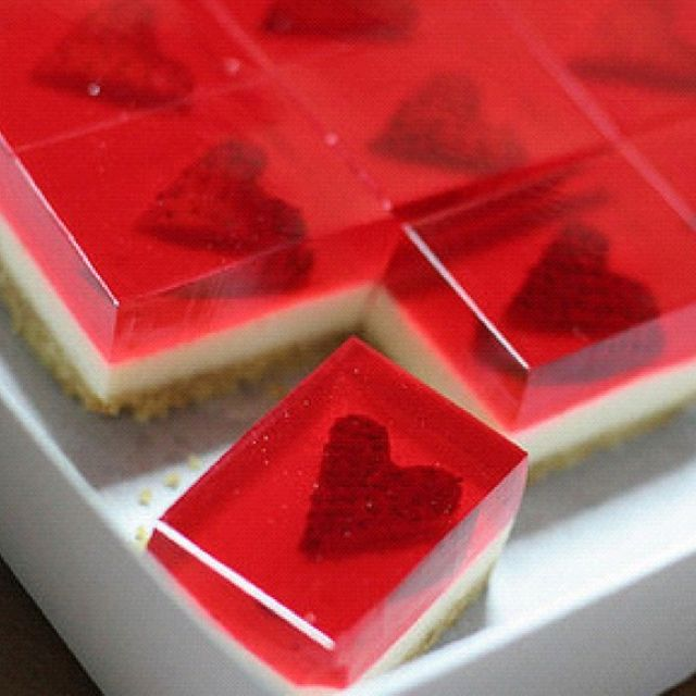 Adapt a cheesecake recipe to a shallow tray and top with a jelly made with agar agar   <3 strawberry heart cheesecake bites