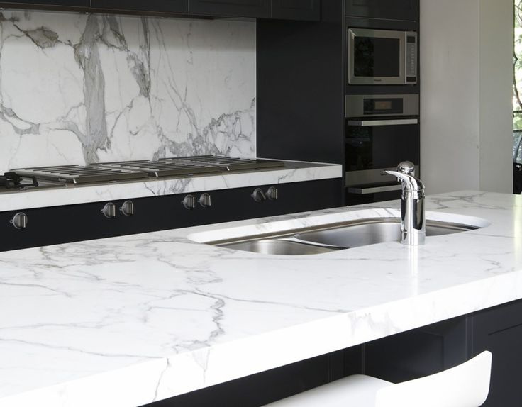 Ceaserstone calacatta. Not marble.... I want this so bad.
