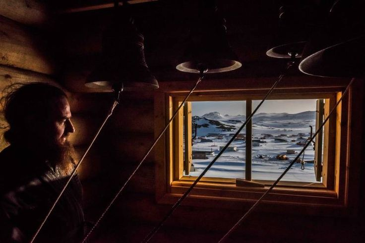 Daily Life, 1st prize stories. A priest looks on in the Bell room, after a vigil at the Russian Orthodox Church of the Holy Trinity; Fildes Bay, Antartica, Dec. 3, 2015.