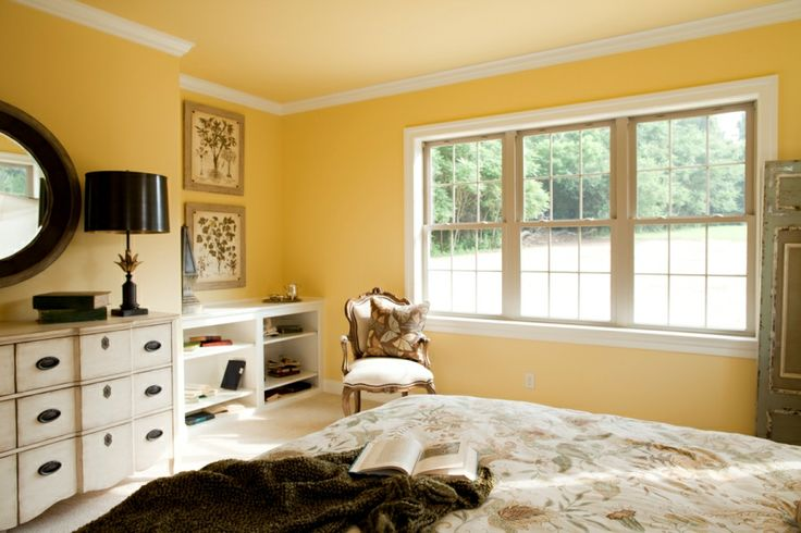 Master Bedroom With Crown Molding A Bright Yellow Wall