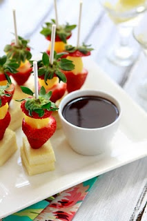 Fruit appetizers with strawberry, pineapple and cheese