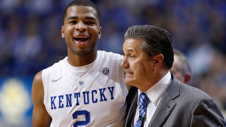 LEXINGTON, KY - JANUARY 20: Aaron Harrison #2 of the Kentucky Wildcats gets a hug from head coach John Calipari in the second half of the game against the Vanderbilt Commodores at Rupp Arena on January 20, 2015 in Lexington, Kentucky. Kentucky defeated Vanderbilt 65-57. (Photo by Joe Robbins/Getty Images)