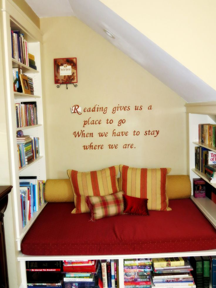 """ reading book nook"" alcove under the staircase"