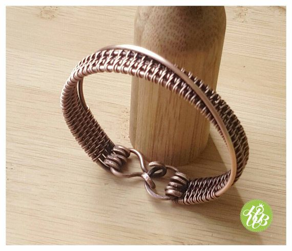 Listing for one simple wire copper cuff. This woven copper bangle is entirely handmade, antiqued, polished by hand. I treat all my jewelry with a special wax to protect the copper and for long lasting patina. The clasp of this wire wrapped bracelet is also hammered and handcrafted. Measurements : The inside diameter of THE LISTED bracelet is 2,48inch (6.3cm) and fits for an wrist of 6.25inch -6.5inch (about 16cm) PLEASE NOTE : If the listed copper wire bracelet is not your size, please…