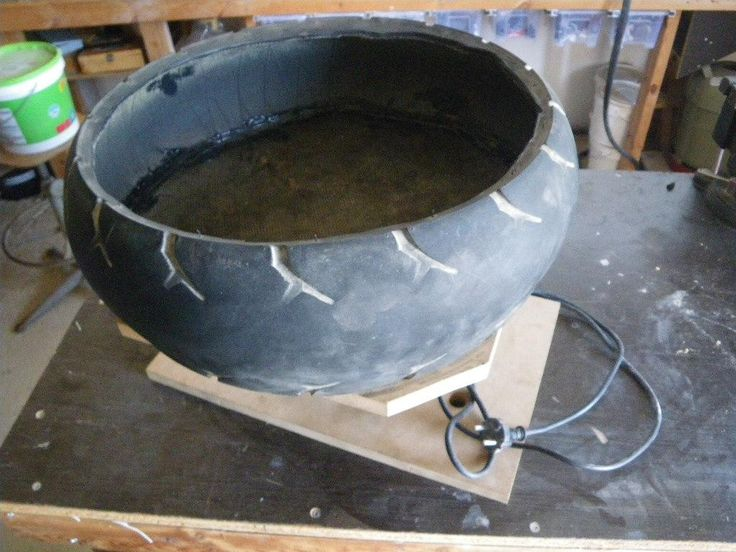 Vibratory Tumbler by Lykle -- Homemade vibratory tumbler constructed from a surplus buffer, juicer, scooter tire, stainless steel channel, rubber, and wood.  http://www.homemadetools.net/homemade-vibratory-tumbler-4