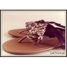 Sandals in purple with fabric.