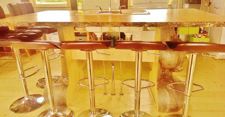 Industrial modern custom made with 6 bar stools.  A white double blanco sink faces the ocean.