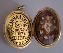 "VICTORIAN gold hair locket with black enameled ""IMO' on front, ""Hannah Taylor, born June 23, 1872 died July 30, 1876, Rest in Jesus"" and hair curls inside, 1-5/8"" by 1-1/4"""