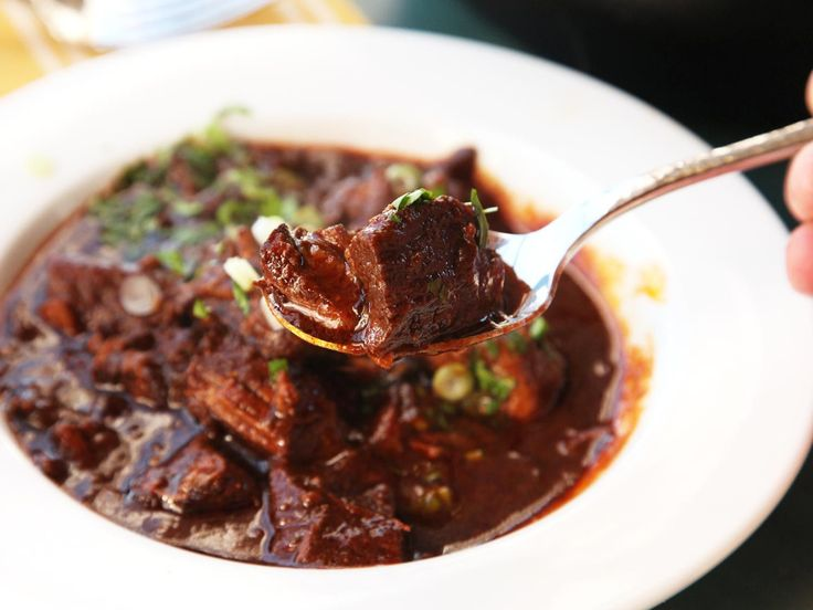 Real Texas chile con carne is made with beef, chilies, and not a whole lot else. This is the real deal: a bowl of hot Texas red with fall-apart tender beef chuck and fresh dried chilies.