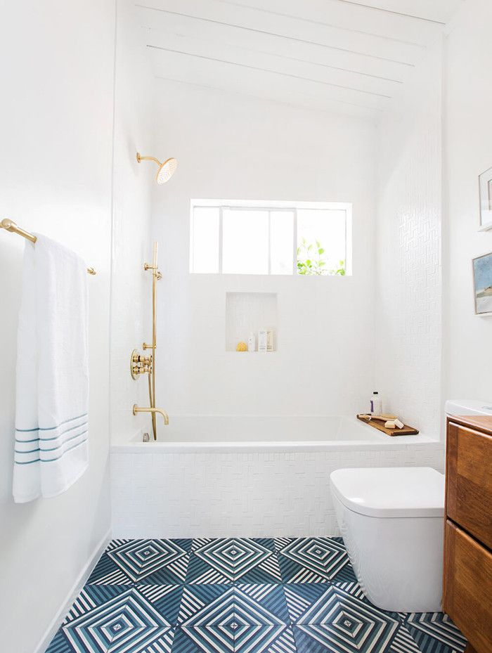 """""""In both my master and guest bath I gave the walls a good coat of Benjamin Moore's Super White, which is my go-to bright white for any room. It instantly bounces light around the room and gives it life. In the case of my bathrooms, it really served as the perfect accent color on the walls to let the beautiful and handmade tile do all the talking—and boy does that tile have a lot to say."""""""
