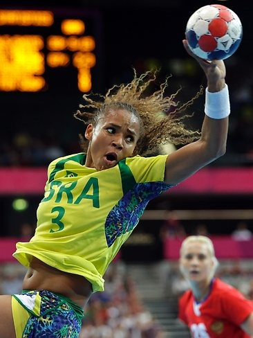 Brazil's Alexandra Nascimento falls during the women's handball preliminary match against Russia,London Olympics 2012.