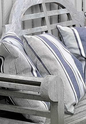 Striped cushions on a grey bench- lovely...