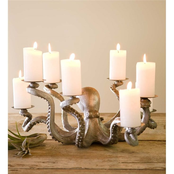 This dramatic Octopus Candle Holder will be a statement piece on any large table. The stately denizen of the deep is eager to lend a hand—or eight!—as each of his tentacles clutches a base ready to ho