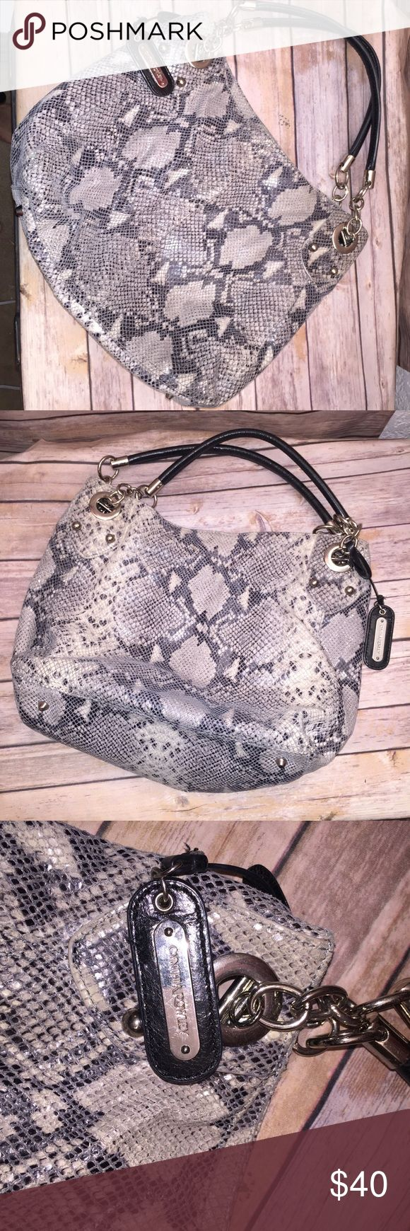 Cynthia Rowley Genuine Leather Bag Excellent Used Condition. Inside shows signs of wear which can be washed out. Outside is soft leather. Snake Motif colors are Cream and black Cynthia Rowley Bags Totes