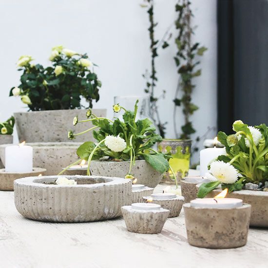 Put Concrete to Use in Multiple Ways Because candleholders typically are small, they are good practice projects for working with concrete. Try using empty yogurt containers or margarine tubs as molds. Before the concrete for a candleholder sets, oil a candle and insert it in the concrete to get the right fit. (Clean the oil off the candle before lighting.)