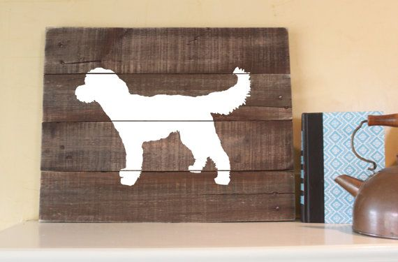 A simple, rustic silhouette of your favorite dog on reclaimed wood! This sign measures approximately 16Wx14H. Wall hangers are included on the back.