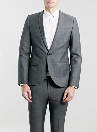 """FROM MONDAY: This skinny suit from Topman is sleek and narrow. It is a fashion forward grey suit made with polyester and wool. This is a staple item for every man's wardrobe. In addition, to keep up to date with the media it is a """"Fifty Shades of Grey"""" inspired choice that is timeless and modern."""