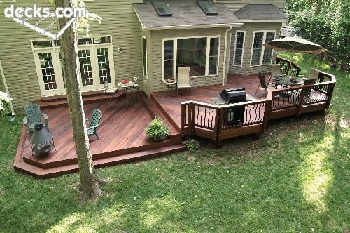 low levels and shapes like the low level deck on an angle with fire pit conversation area and sep area for grill and also diff shape area for dining