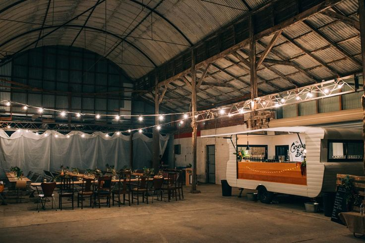 Indoor, rustic yet modern shed wedding - Ahhh Heck Yes! The Caravan Bar looking right at home.