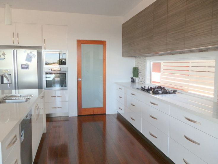 Contemporary kitchen with timber contrast overhead cabinets
