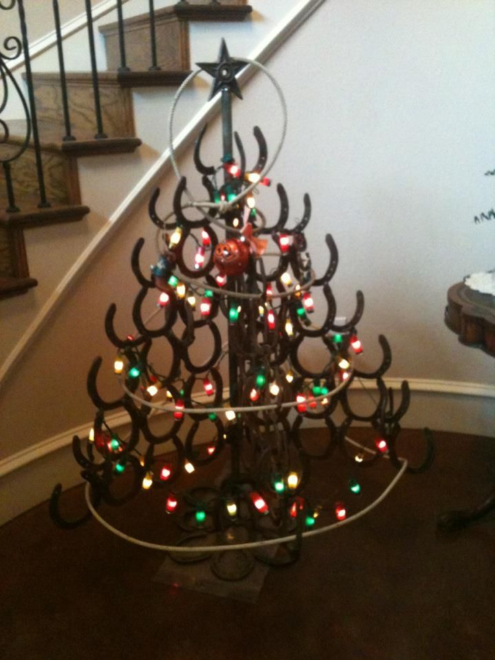Horseshoe christmas tree we made for my mom welding for How to decorate horseshoes