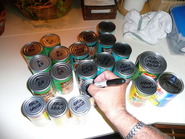 If storing canned goods under seating, etc, label tops with permanent marker. You can just grab what you need without picking up each can to look. Simple but brilliant.