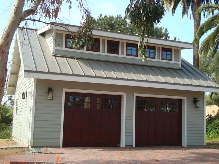 Olive exterior paint, stark white trim, window trim painted to match the garage doors. Love.