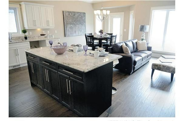 White shaker style cabinets and dark island kitchen for Shaker style kitchen with island