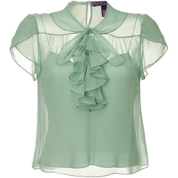 Delicate top of fine, light green silk. Transparent look is feminine and romantic. Thin-strapped tank underneath. Elegant look with ruffled neck tie, short-wai…