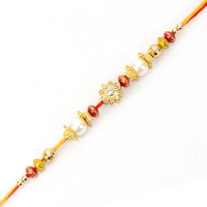 Surprising your dear brother this Rakhi with Giftblooms.com was never been this easy and hassle free. Now with the wide galore of gifts arranged at the site shopping here is now fun! This floral Rakhi bracelet comes with beads works. Golden floral design with golden balls and red decoratives enhance its beauty.