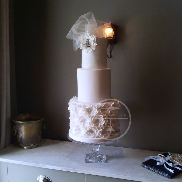 One of our most popular cake designs.  Sugar ruffle roses and soft tulle.