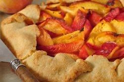 This rustic looking Peach Tart combines a buttery crisp pastry with sweet and juicy sliced peaches. From Joyofbaking.com With Demo Video