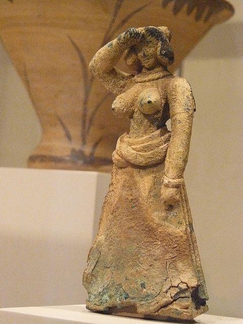 Bronze female figure Cretan Late Minoan I 1600-1450 BCE    Photographed at the Metropolitan Museum of Art in New York City, New York.
