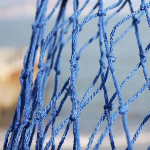 These decorative fishing nets have been gathered at each end to form a perfect swag, though the netting can be changed for draping in your own coastal style.