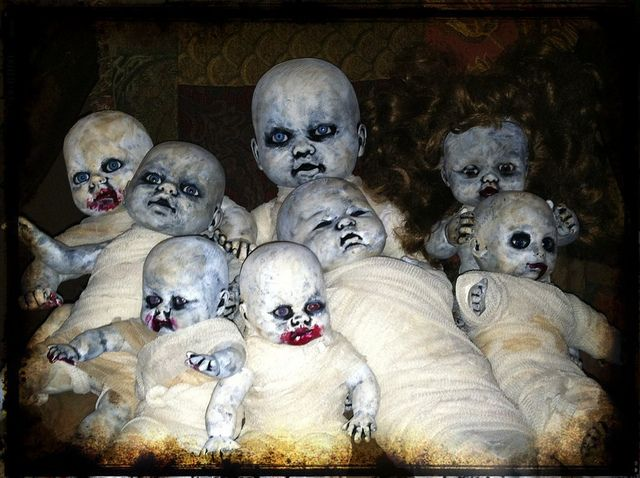 Very creepy doll grouping.