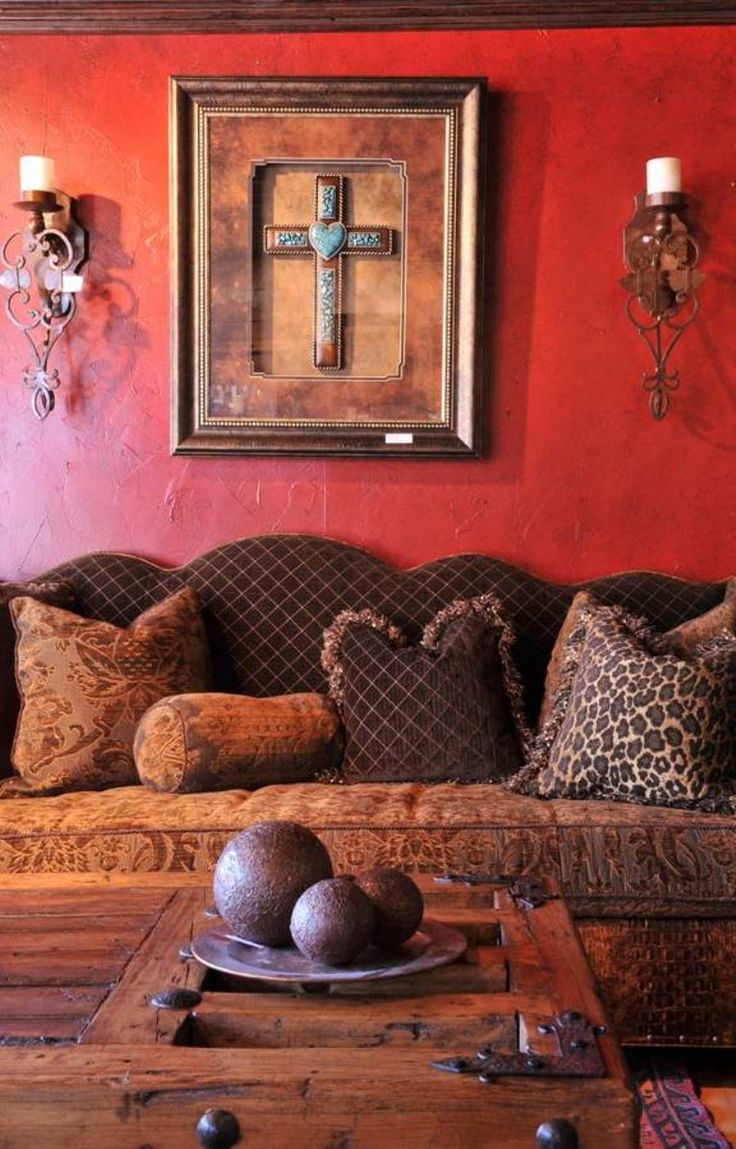Living Room , Lively Mexican Style Living Room : Mexican Style Living Room With Red Wall And Sconces And Wall Hanging Art And Brown Couch And Wooden Coffee Table