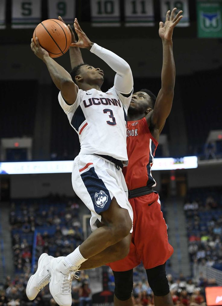 UConn guard Jalen Adams came back from a one-game suspension to score 19 points and the Huskies came from behind to beat Stony Brook 72-64 on Tuesday night.