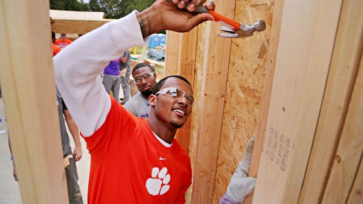 When he was young, Deshaun Watson moved out of government housing and into a Habitat for Humanity house his mother helped build. Now the Clemson quarterback is giving back.