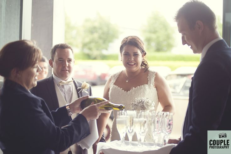 A champagne reception. Weddings at Mullingar Park Hotel by Couple Photography.