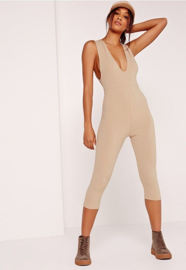 Classic, sassy and completely badass, this camel jumpsuit is a heart breaker. The ribbed design and sexy plunge neckline keeps this piece looking chic and luxe without the heavy dollar sign. Team the 3/4 length jumpsuit with a bomber jacket...
