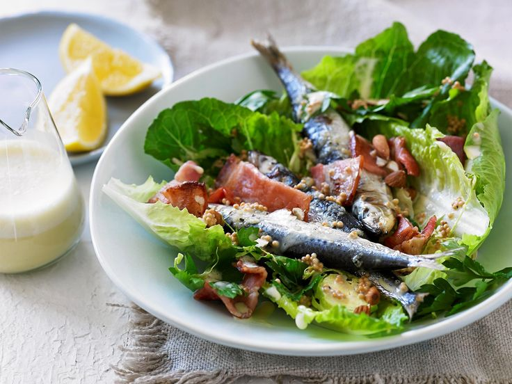 This Caesar salad recipe from Scott Gooding's book, Clean Living, includes grilled sardines, crisp bacon and brussels sprouts for a healthier, Paleo version of the classic salad.