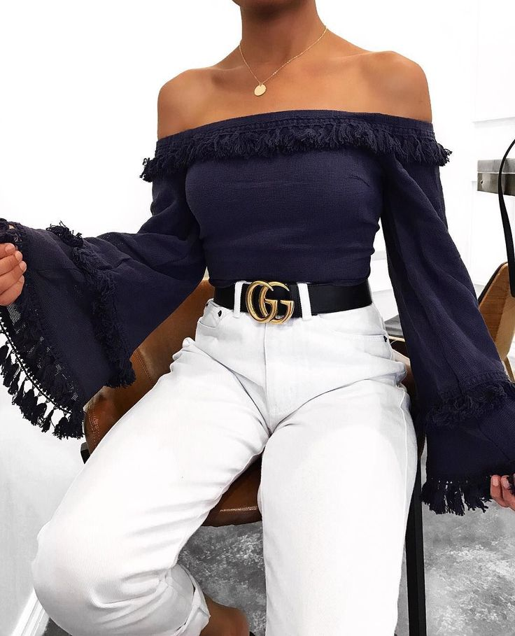 Off the shoulder navy blue wide sleeve blouse, paired with white pants and Gucci black belt.