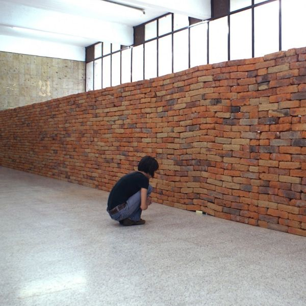 Installation Reveals The Metaphoric Power Of A Single Book Distorting A Solid Brick Wall Brick Art Installation Art Book Installation